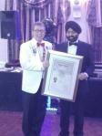 131116 - Charter - Coventry Mercia - Club Formation - 016 - Presenting the Charter - DG Simon President Sundip